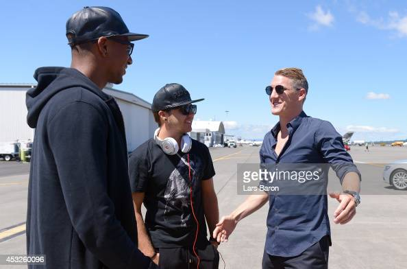 Bastian Schweinsteiger speaks with Jerome Boateng at the airport during day eight of the Bayern Muenchen Audi Summer Tour USA 2014 on August 6 2014...