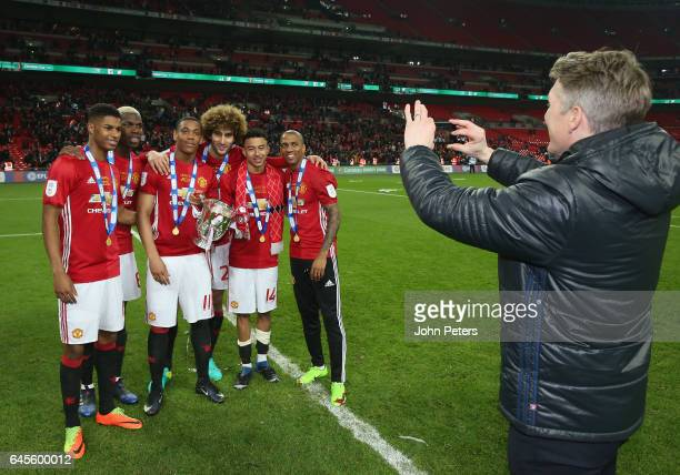 Bastian Schweinsteiger takes a photo of Marcus Rashford Paul Pogba Anthony Martial Marouane Fellaini Jesse Lingard and Ashley Young of Manchester...