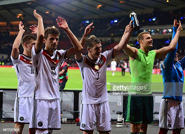 Bastian Schweinsteiger Thomas Muller and Manuel Neuer of Germany celebrate at the final whistle during the EURO 2016 Qualifier between Scotland and...