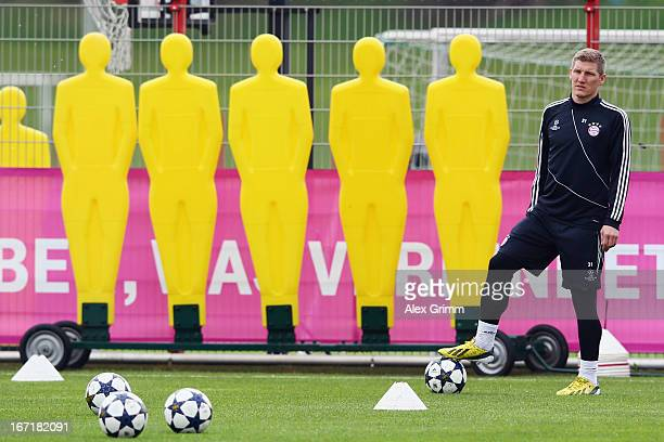 Bastian Schweinsteiger waits for a Bayern Muenchen training session ahead of their UEFA Champions League Semi Final first leg match against FC...
