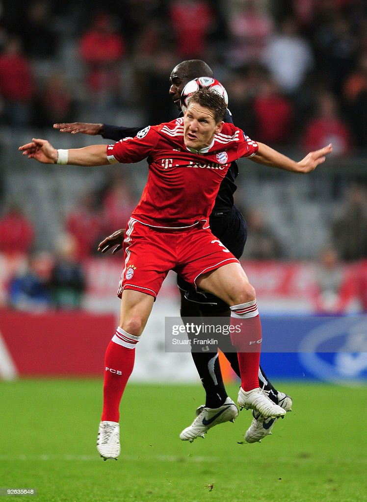 Bastian Schweinstieger of Bayern and <a gi-track='captionPersonalityLinkClicked' href=/galleries/search?phrase=Alou+Diarra&family=editorial&specificpeople=465019 ng-click='$event.stopPropagation()'>Alou Diarra</a> of Bordeaux jump for header during the UEFA Champions League Group A match between FC Bayern Muenchen and FC Girondins de Bordeaux at Allianz Arena on November 3, 2009 in Munich, Germany.