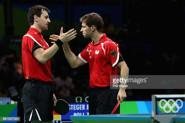 Bastian Steger and Timo Boll of Germany celebrate winning the doubles match during the Men's Team Bronze Medal match between Korea and Germany at the...