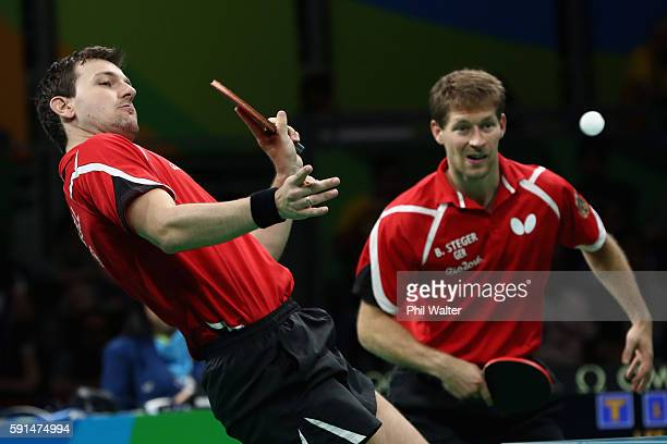 Bastian Steger and Timo Boll of Germany in action in the doubles match during the Men's Team Bronze Medal match between Korea and Germany at the Rio...