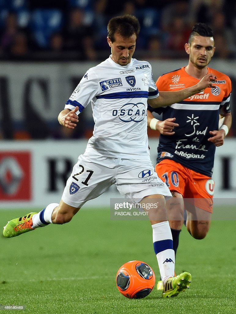 Bastia's Algerian defender Fethi Harek vies for the ball with Montpellier's French midfielder Remy Cabella during the French L1 football match...
