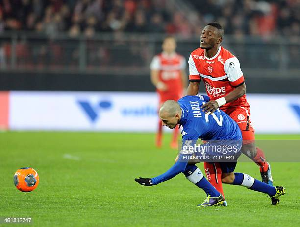 Bastia's Algerian defender Fethi Harek vies for the ball with Valenciennes's Majeed Waris during the French L1 football match Valenciennes vs Bastia...