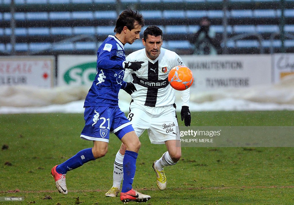 Bastia's Algerian defender Fethi Harek (L) vies for the ball with Rennes' French midfielder Julien Feret during the French L1 football match between Bastia and Rennes, on January 20, 2013, at the Jean Laville stadium in Gueugnon.