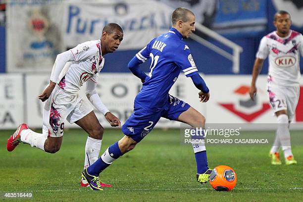 Bastia's Algerian defender Fethi Harek vies with Bordeaux's Uruguayan forward Diego Rolan during the French L1 football match Bastia against Bordeaux...