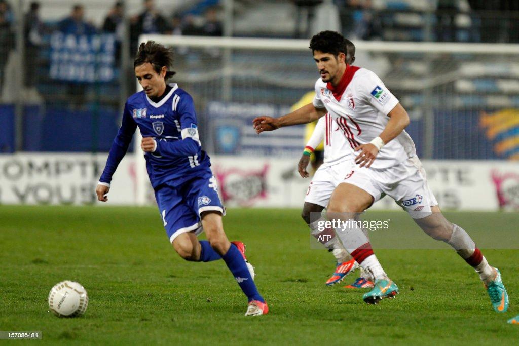 Bastia's Algerian defender Fethi Harek vies with Lille's Brazilian forward Tulio De Melo during the French League Cup football match Bastia vs Lille...