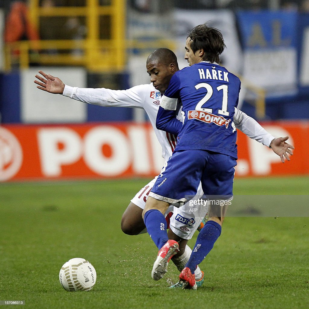 Bastia's Algerian defender Fethi Harek vies with Lille's French defender Dijbril Sidibe during the French League Cup football match Bastia vs Lille...