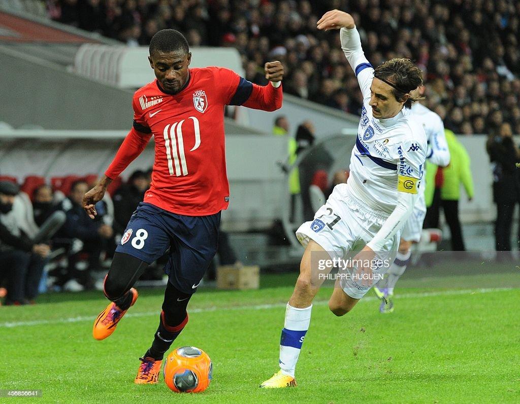 Bastia's Algerian defender Fethi Harek vies with Lille's Ivorian forward Salomon Kalou during the French L1 football match Lille vs Bastia on...