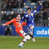 Bastia's Algerian defender Fethi Harek vies with Lorient French forward Jeremie Aliadiere during the French L1 football match between Bastia and...