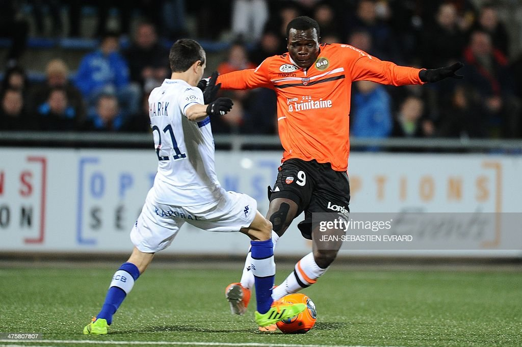 Bastia's Algerian defender Fethi Harek vies with Lorient's forward Vincent Aboubakar during the French L1 football match between Lorient and Bastia...