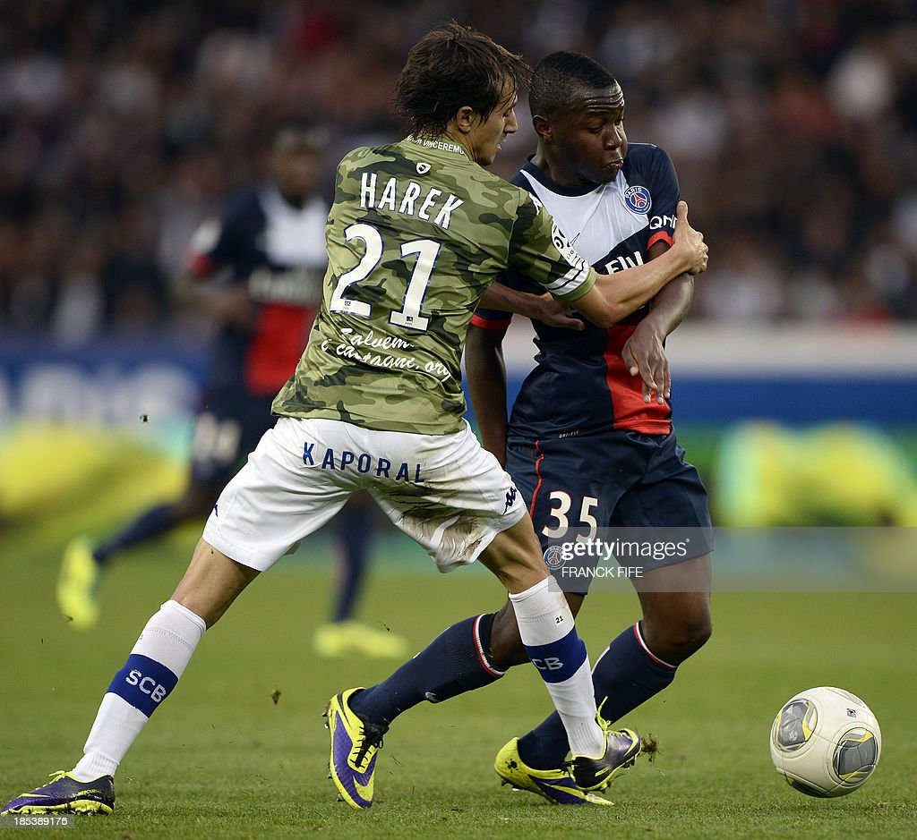 Bastia's Algerian defender Fethi Harek vies with Paris SaintGermain's French forward Hervin Ongenda during the French L1 football match Paris Saint...