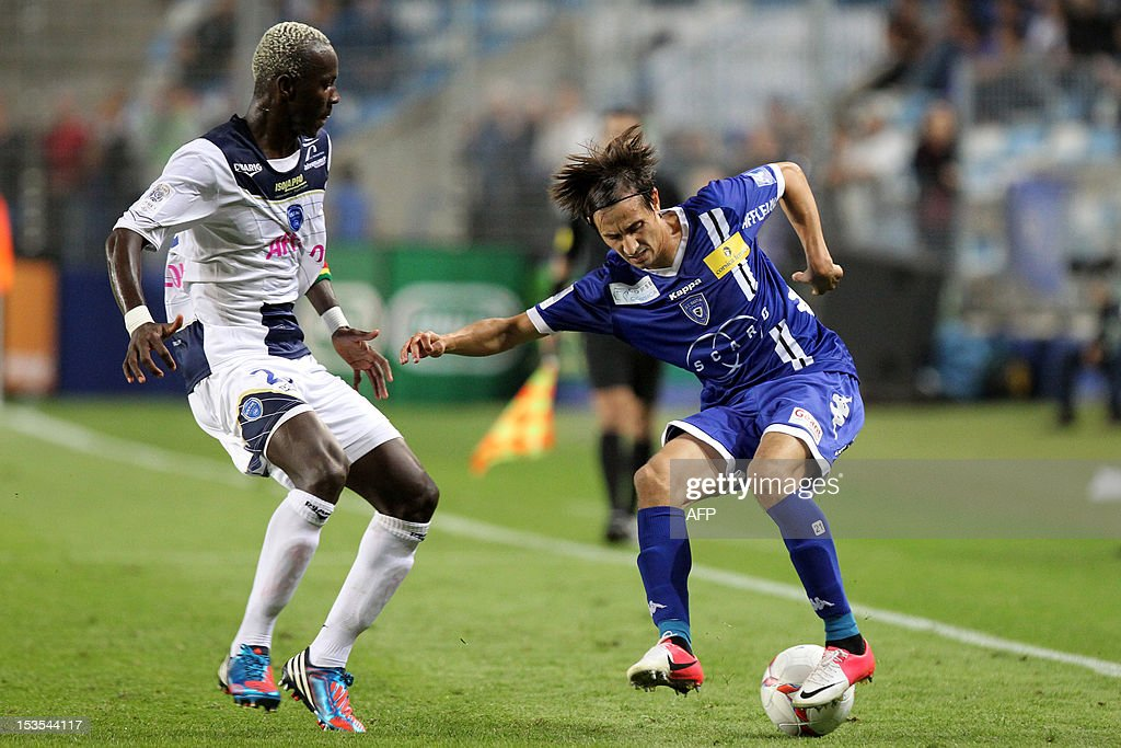 Bastia's Algerian defender Fethi Harek (R) vies with Troyes' French defender Lamine Mohamed Yattara during the French L1 football match Bastia (SCB) vs Troyes (ESTAC) at the Armand Cesari stadium in Bastia, Corsica, on October 6, 2012.