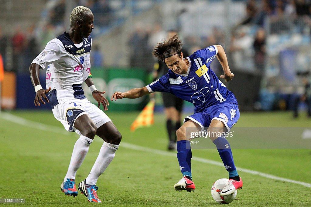 Bastia's Algerian defender Fethi Harek vies with Troyes' French defender Lamine Mohamed Yattara during the French L1 football match Bastia vs Troyes...