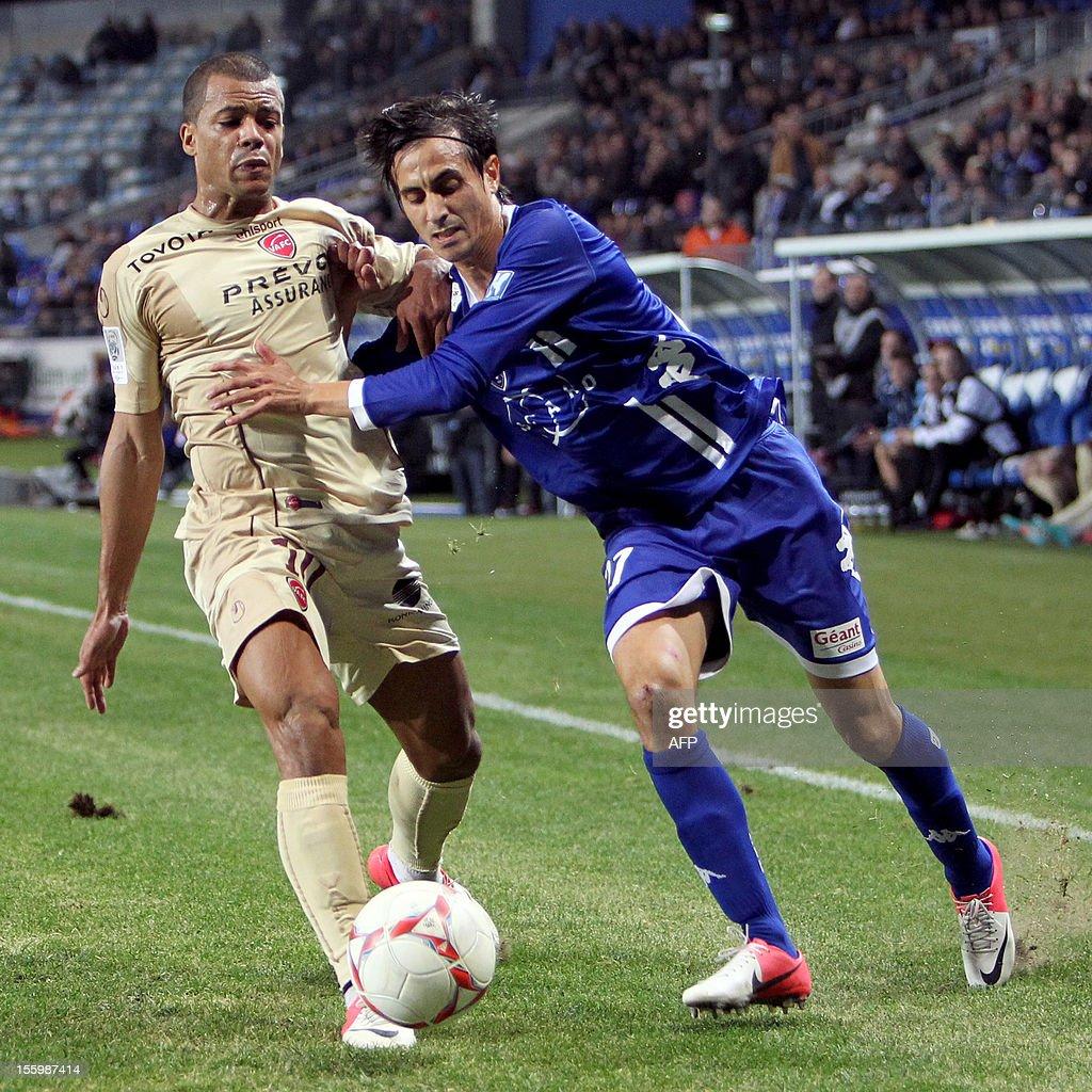 Bastia's Algerian defender Fethi Harek vies with Valenciennes' midfielder Mathieu Dossevi during the French L1 football match Bastia vs Valenciennes...