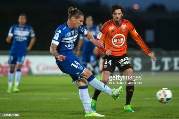 Bastia's Algerian midfielder Mehdi Mostefa vies with Lorient's French forward Jeremie Aliadiere during the French L1 football match Bastia vs Lorient...