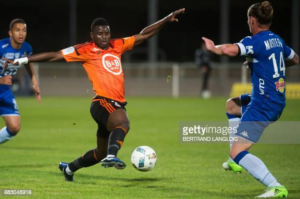Bastia's Algerian midfielder Mehdi Mostefa vies with Lorient's midfielder Alhassan Wakaso during the French L1 football match Bastia vs Lorient on...