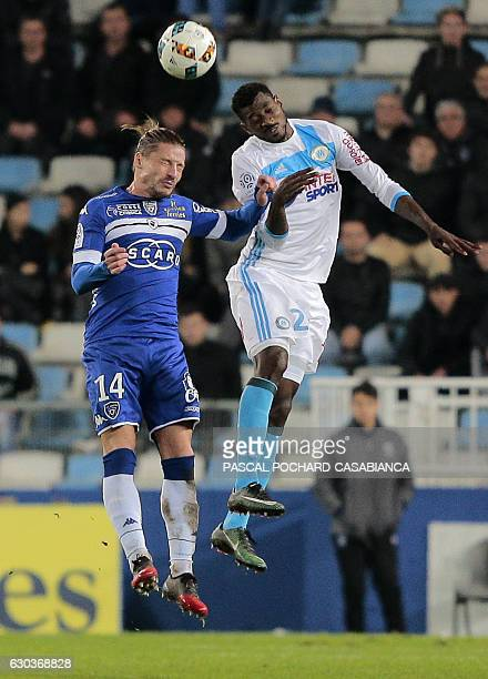 Bastia's Algerian midfielder Mehdi Mostefa vies with Marseille's French midfielder AndreFrank Zambo Anguissa during the French L1 football match...