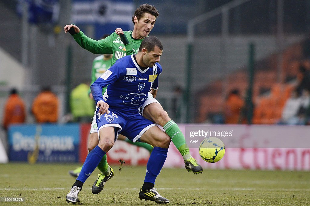 Bastia's Brazilian forward Araujo Ilan (R) vies with Saint-Etienne's French midfielder Jeremy Clement (L) during the French L1 football match AS Saint-Etienne (ASSE) vs Bastia (SCB) on January 27, 2013, at the Geoffroy Guichard Stadium in Saint-Etienne, central France.
