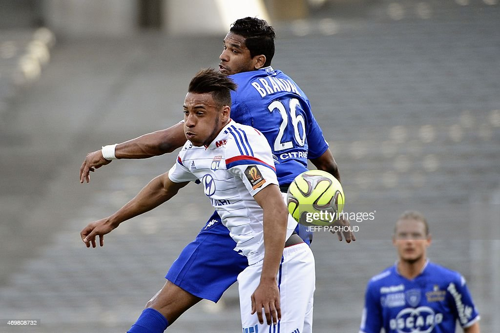 Bastia's Brazilian forward Brandao (R) vies with Lyon's French midfielder Corentin Tolisso during the French L1 football match Olympique Lyonnais (OL) vs SC Bastia (SCB) on April 15, 2015, at the Gerland Stadium in Lyon, central-eastern France.
