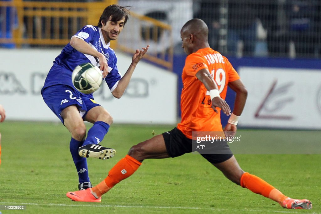 Bastia's Fethi Harek vies with Chateauroux' Claudio Beauvue during the French L2 football match Bastia vs Chateauroux in the Furiani stadium in Bastia, Corsica, on April 23, 2012.