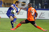 Bastia's Fethi Harek vies with Chateauroux' Claudio Beauvue during the French L2 football match Bastia vs Chateauroux in the Furiani stadium in...