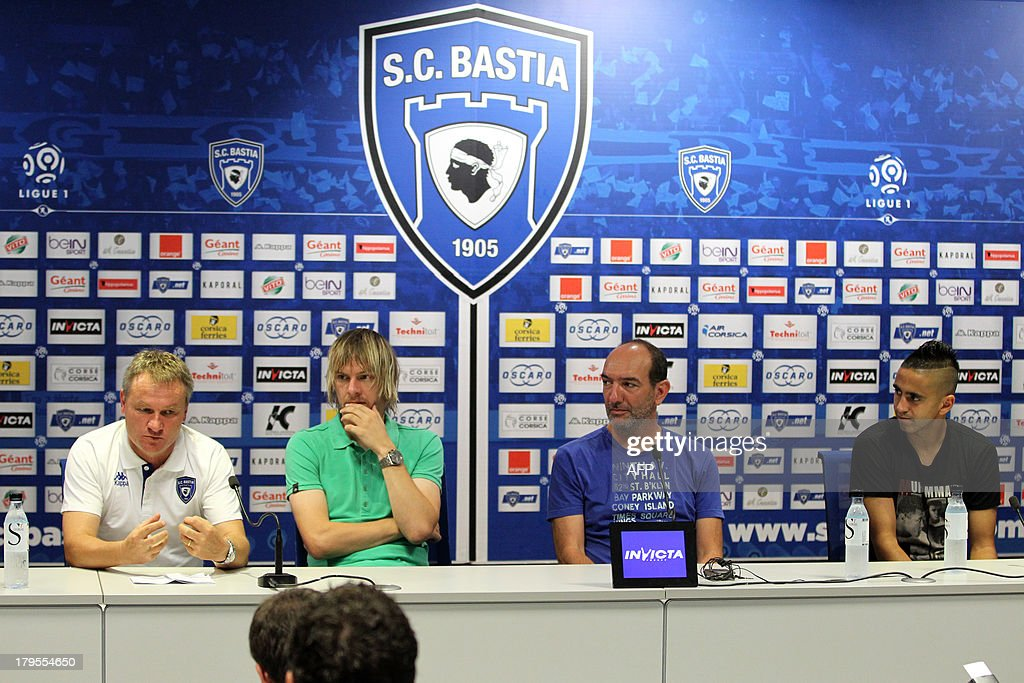 Bastia's football club president Pierre Marie Geronimi (2ndR) and Bastia's head coach Frederic Hantz (L) present to journalists Bastia's recently recruited Serbian forward Milos Krasic (2ndL) and Algerian forward Ryad Boudebouz (R) on September 5, 2013, in the Armand Cesari stadium in Bastia, on the French Mediterranean Island of Corsica.