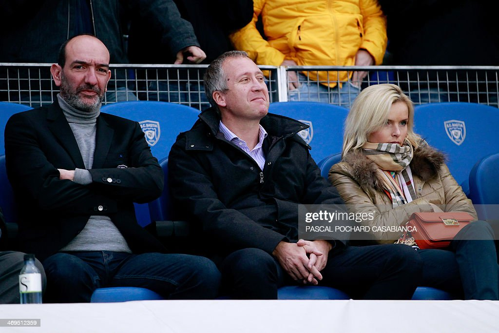 Bastia's football club president Pierre-Marie Geronimi (L), Monaco's Russian sporting director Vadim Vasilyev (C) and an unidentified woman attend the French L1 football match Bastia (SCB) vs Monaco (ASM) at the Armand Cesari stadium in Bastia, Corsica island, on February 15 , 2014. AFP PHOTO / PASCAL POCHARD-CASABIANCA
