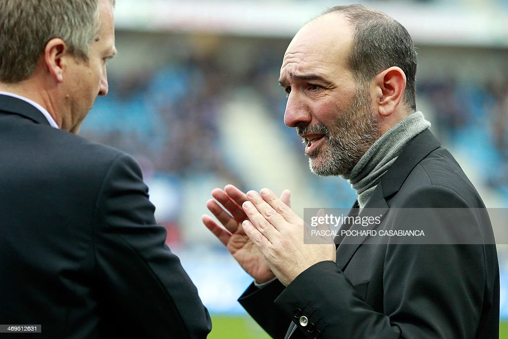 Bastia's football club president Pierre-Marie Geronimi (R) speaks with Monaco's football club Russian vice-president Vadim Vasilyev prior to the French L1 football match Bastia (SCB) vs Monaco (ASM) at the Armand Cesari stadium in Bastia, Corsica island, on February 15 , 2014.