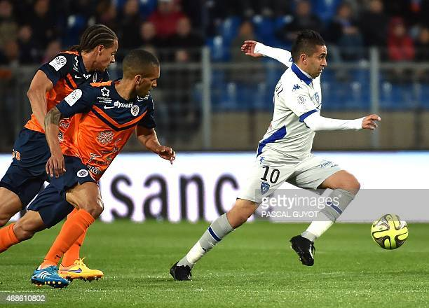 Bastia's Franco Algerian midfielder Ryad Boudebouz vies with Montpellier's French midfielder Joris Marveaux and Montpellier's French defender Daniel...