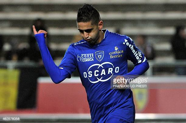 Bastia's French Algerian midfielder Ryad Boudebouz celebrates after scoring during the French L1 football match between Lens and Bastia at the...