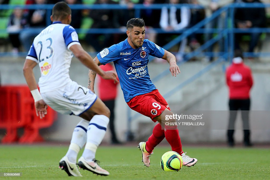 Bastia's French defender Alexander Djiku (L) vies for the ball with Caen's French forward Andy Delort during the French L1 football match between Caen (SMC) and Bastia (SCB) on April 30, 2016, at the Michel d'Ornano Stadium in Caen, northwestern France.