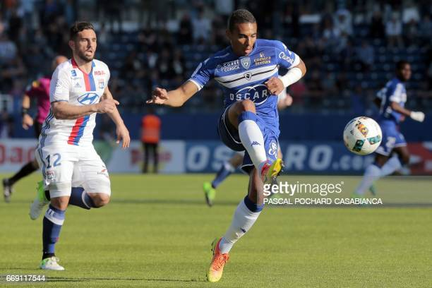 Bastia's French defender Alexander Djiku vies with Lyon's French midfielder Jordan Ferri during the French L1 Football match between Bastia and Lyon...