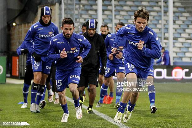 Bastia's French defender Julian Palmieri and Bastia's French midfielder Yannick Cahuzac warm up prior to the French L1 football match between Bastia...