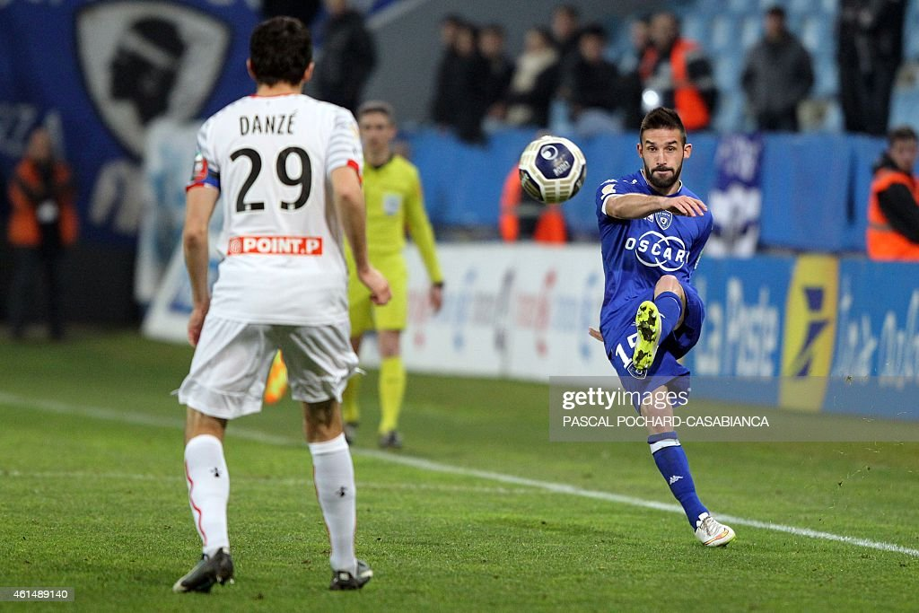 Bastia's French defender Julian Palmieri (R) kicks the ball in front of Rennes' French defender <a gi-track='captionPersonalityLinkClicked' href=/galleries/search?phrase=Romain+Danze&family=editorial&specificpeople=4121826 ng-click='$event.stopPropagation()'>Romain Danze</a> during the French Ligue Cup football match between Bastia (SCB) and Rennes (SRFC) on January 13, 2015 at the Armand Cesari stadium in Bastia, on the French Mediterranean island of Corsica.