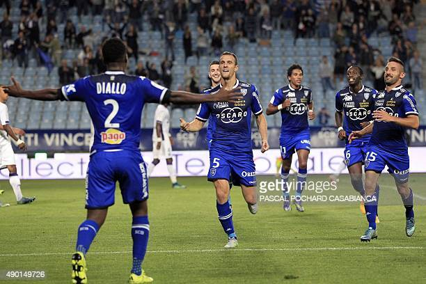 Bastia's French defender Sebastien Squillaci celebrates with teammates after scoring a goal during the French L1 football match Bastia against...