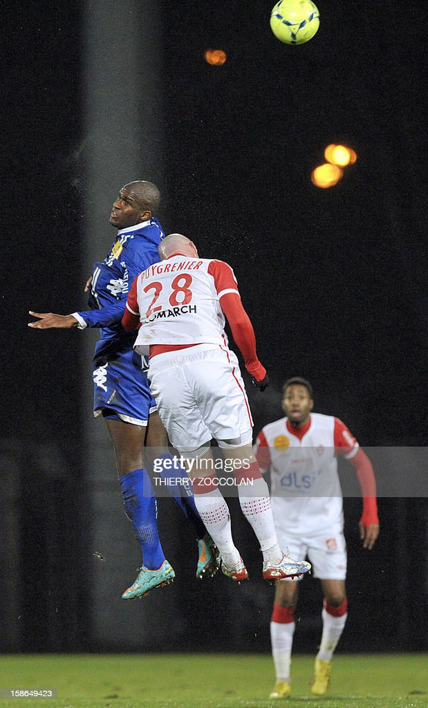 Bastia's French forward Anthony Modeste (L) vies for the ball with Nancy's French defender Sebastien Puygrenier during the French L1 football match Bastia vs Nancy, on December 22, 2012, at the Jean Laville stadium in Gueugnon. AFP PHOTO / THIERRY ZOCCOLAN