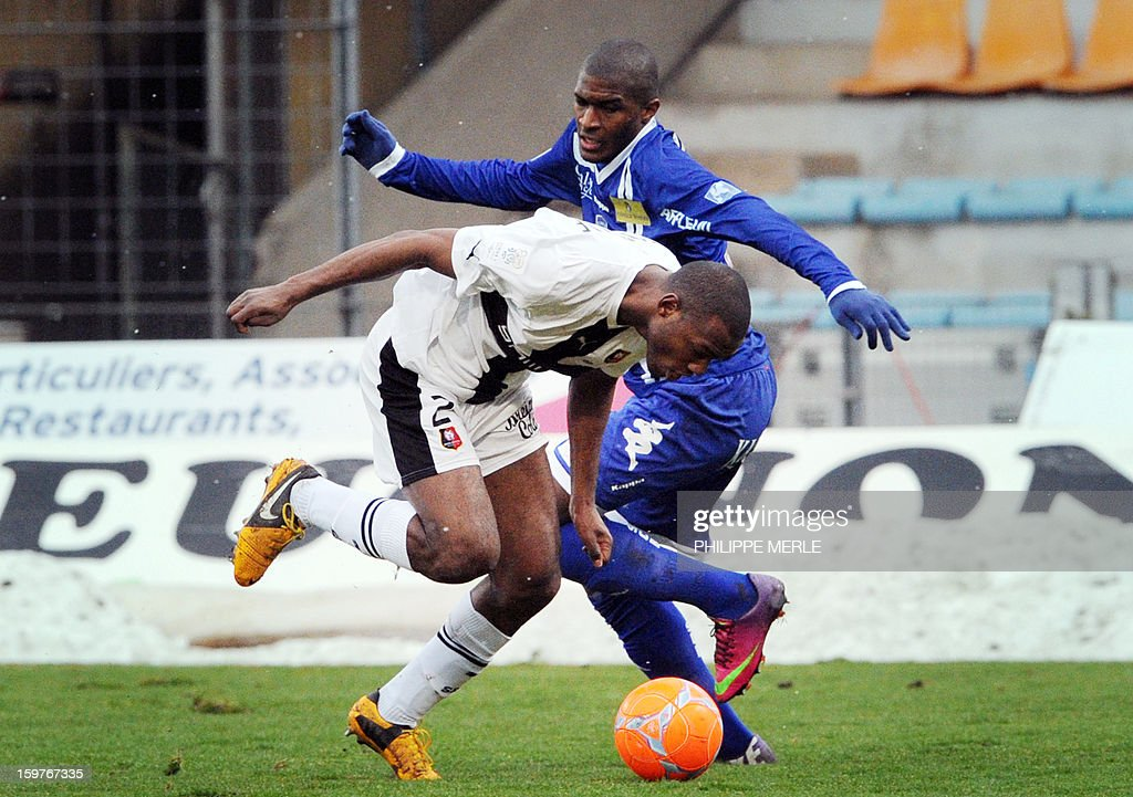 Bastia's French forward Anthony Modeste (R) vies for the ball with Rennes' French defender Kevin Theophile Catherine during the French L1 football match between Bastia and Rennes, on January 20, 2013, at the Jean Laville stadium in Gueugnon.