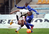 Bastia's French forward Anthony Modeste vies for the ball with Rennes' French defender Kevin Theophile Catherine during the French L1 football match...