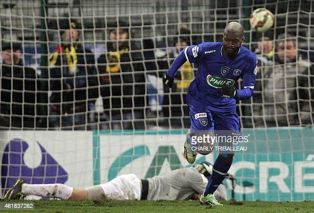 Bastia's French forward Djibril Cisse celebrates after scoring a goal during the French Cup football match between Quevilly and Bastia on January 20...
