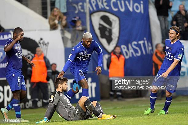 Bastia's French forward Djibril Cisse celebrates by touching Rennes' French goalkeeper Benoit Costil after scoring during the French Ligue Cup...