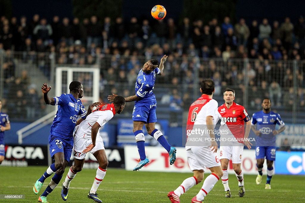 Bastia's French forward Djibril Cisse (C) goes for a header during the French L1 football match Bastia (SCB) against Monaco in the Armand Cesari stadium in Bastia, Corsica, on February 15 , 2014. Monaco defeated Bastia 2-0.