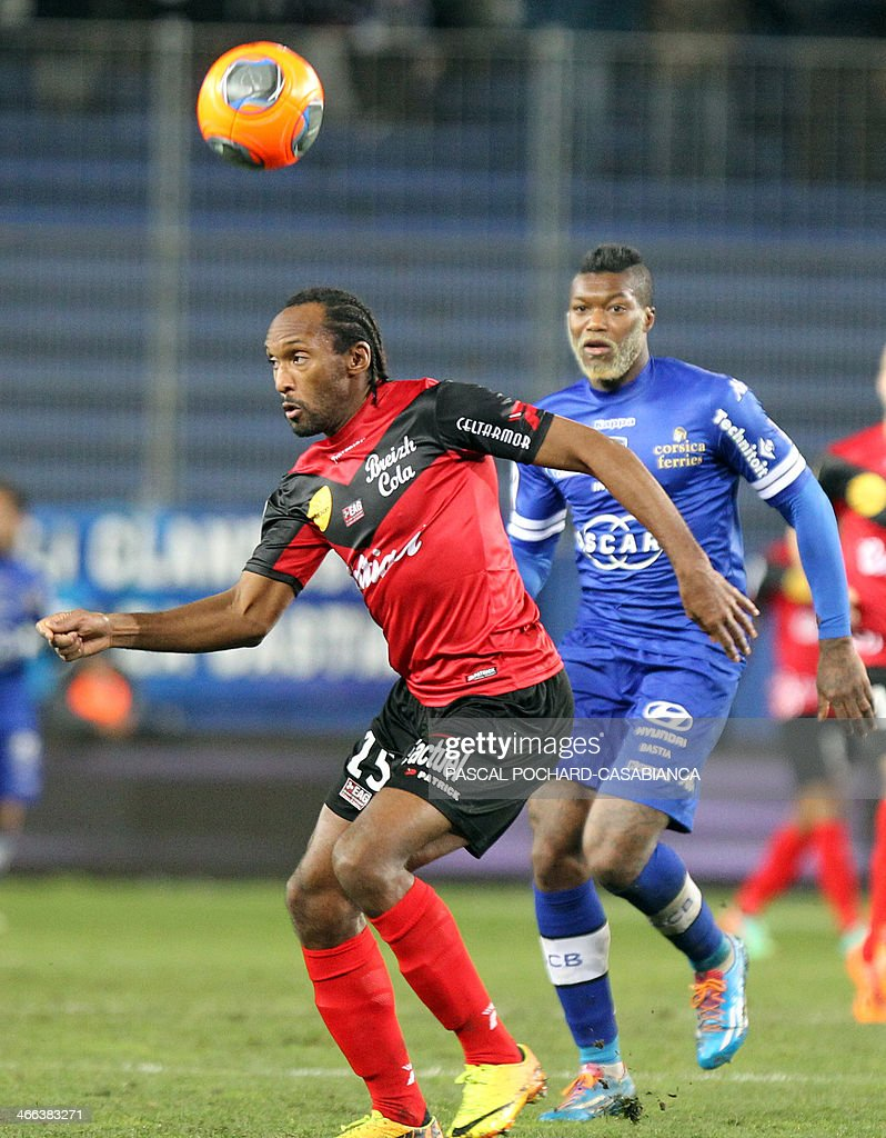 Bastia's French forward Djibril Cisse (R) vies with Guingamp's French defender Reynald Lemaitre during the French L1 football match Bastia (SCB) against Guingamp (AEG) in the Armand Cesari stadium in Bastia,French Mediterranean Island of Corsica, on February 1rst , 2014.