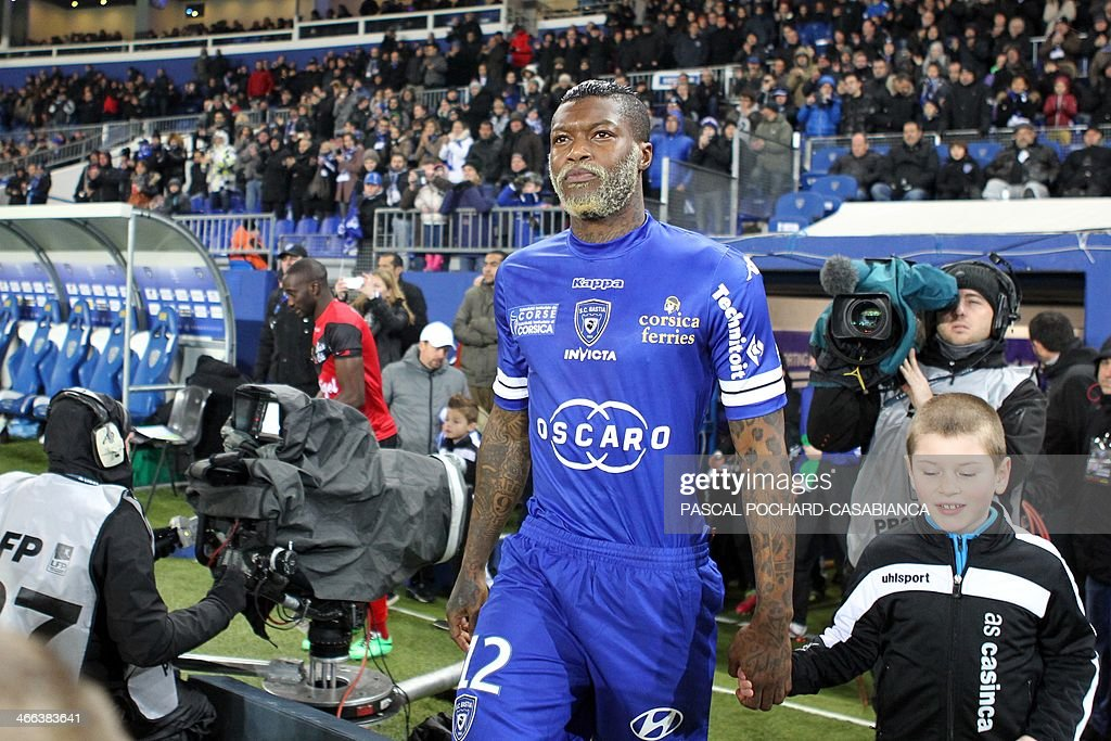 Bastia's French forward Djibril Cisse walks on the field before the French L1 football match Bastia (SCB) against Guingamp (AEG) in the Armand Cesari stadium in Bastia, in the French Mediterranean Island of Corsica, on February 1 , 2014.