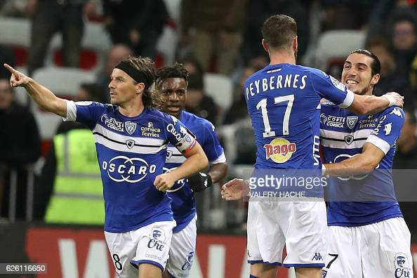 Bastia's French forward Enzo Crivelli celebrates with his teammates after scoring a goal during the French L1 football match between Nice and Bastia...