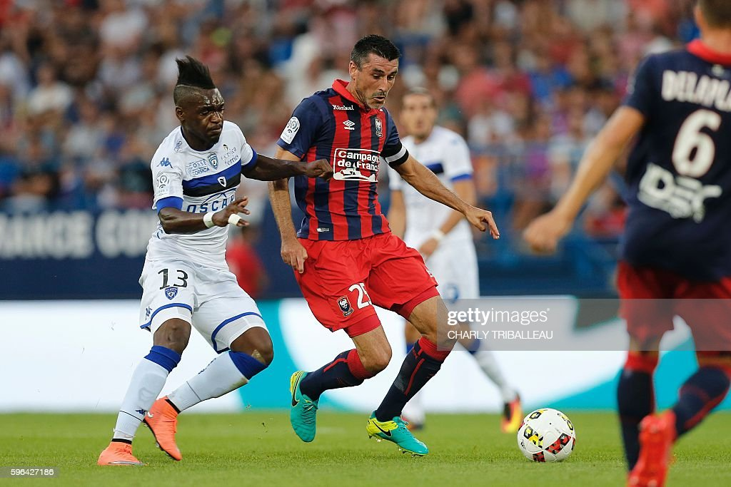 Bastia's French forward Thievy Bifouma vies for the ball with Caen's French midfielder Julien Feret during the French L1 football match between Caen...