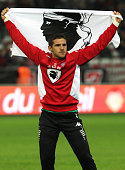 Bastia's French goalkeeper Jean Louis Leca holds the flag of Corsica after Bastia won the French L1 football match between Nice and Bastia on October...