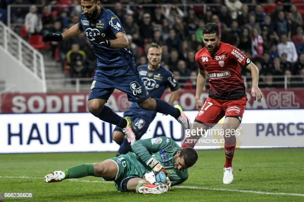 Bastia's French goalkeeper Jean Louis Leca vies with Dijon's FrenchAlgerian midfielder Mehdi Abeid during the French L1 football match between Dijon...