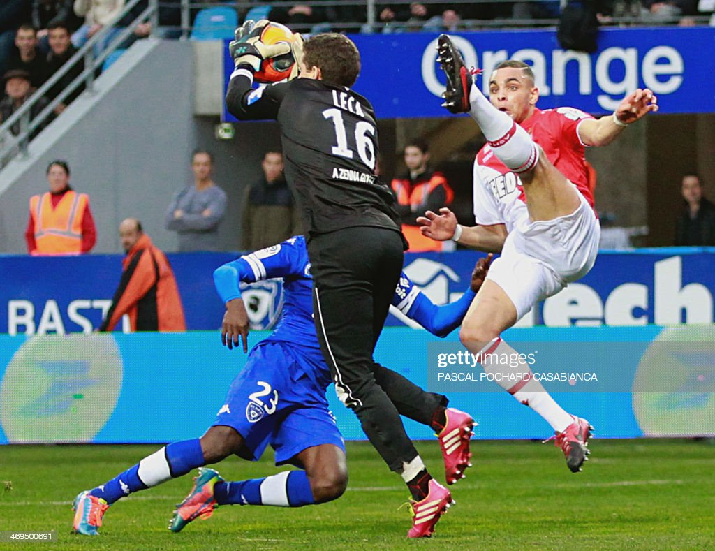 Bastia's French goalkeeper Jean-Louis Leca vies with Monaco's French defender Layvin Kurzawa during the French L1 football match Bastia (SCB) against Monaco (ASM) in the Armand Cesari stadium in Bastia, Corsica, on February 15 , 2014.
